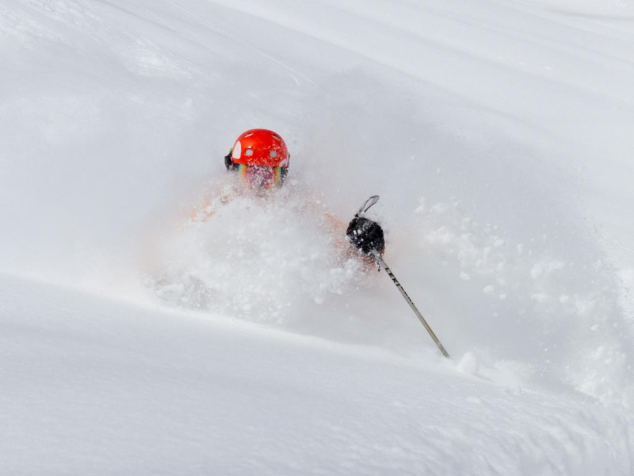 Peter Cullen skis deep powder at Mike Wiegele Heliskiing Resort in BC Canada.