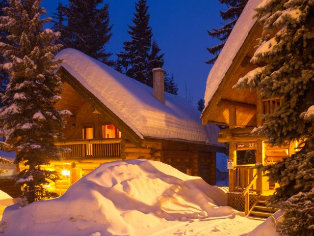 Log chalet ski accommodation at Mike Wiegele Heli-skiing Resort, BC, Canada
